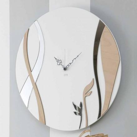 Ora moderne dhe e rrumbullakët e murit me modelin e dekoruar të drurit - Harmonia